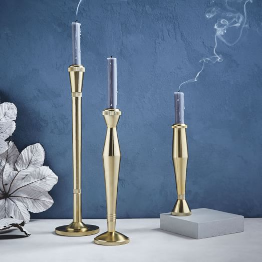 sculpted-metal-candlesticks