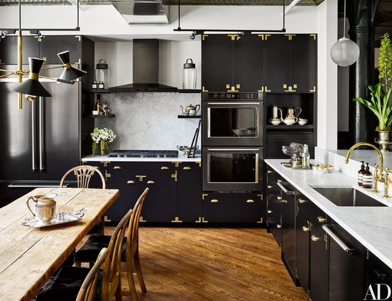 Dark kitchen pendants paired with black cabinets