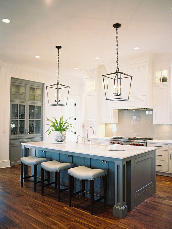 Dark Metal Lanterns over blue kitchen cabinets