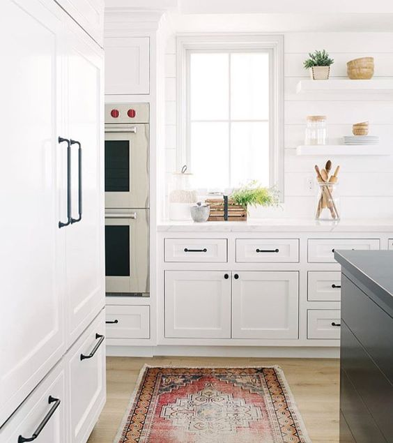 White kitchen with vintage area rug