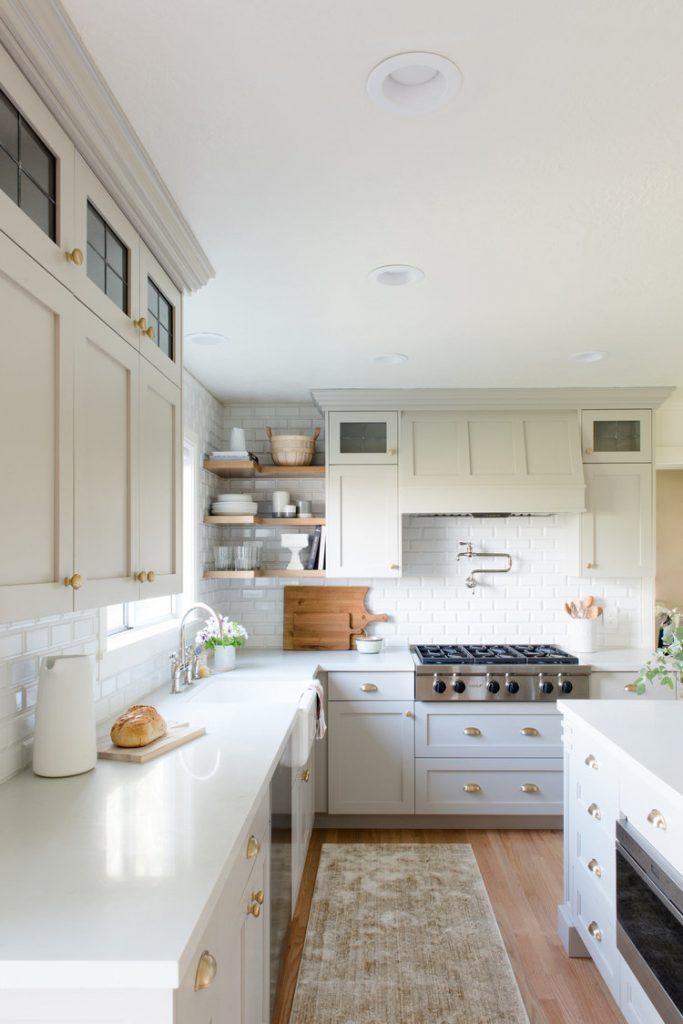 White kitchen with muted rug from Studio McGee