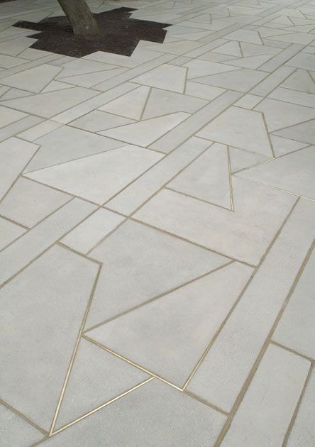 Concrete Floor with Brass Detail | RevolvingDecor.com