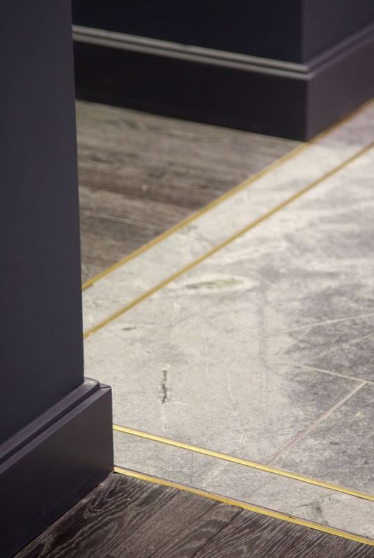 Concrete and Brass Floor | RevolvingDecor.com
